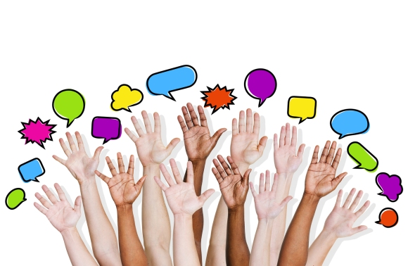 Group of Diverse Multi Ethnic Hands Reaching for Speech Bubbles