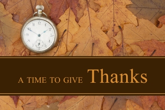 Thankful message Some fall leaves and retro pocket watch with text A Time to give Thanks