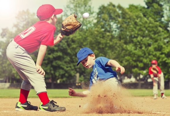 Boy sliding into base during a baseball game with Instagram styl