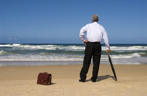 Businessman Dreaming Of Retirement On A Beach.