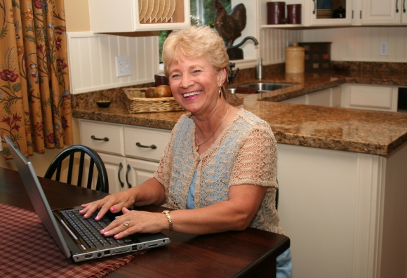 bigstock-Grand-ma-in-the-kitchen-using--15279524